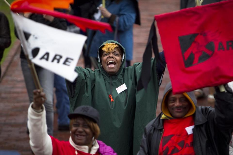 Deirdre Isom, of Providence was among the hundreds of people at a rally on Boston Common, asking lawmakers to work on creating long-term, living-wage jobs.